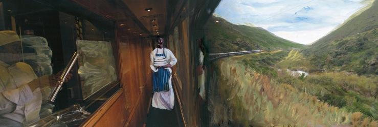 服务员经过火车的厨房,火车转弯时的风景